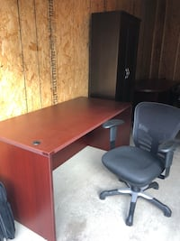 brown wooden desk and black rolling armchair New Albany, 43054