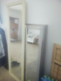 two rectangular white and gray wooden framed mirrors