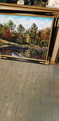brown wooden framed painting of house 791 km