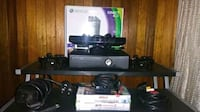black Xbox 360 console with controller and game cases New York