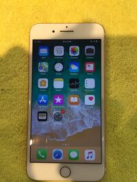 gold iPhone 6 with case 146 mi