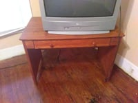 gray CRT TV with brown wooden TV stand Macon, 31206