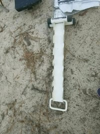 white metal vehicle part with handle