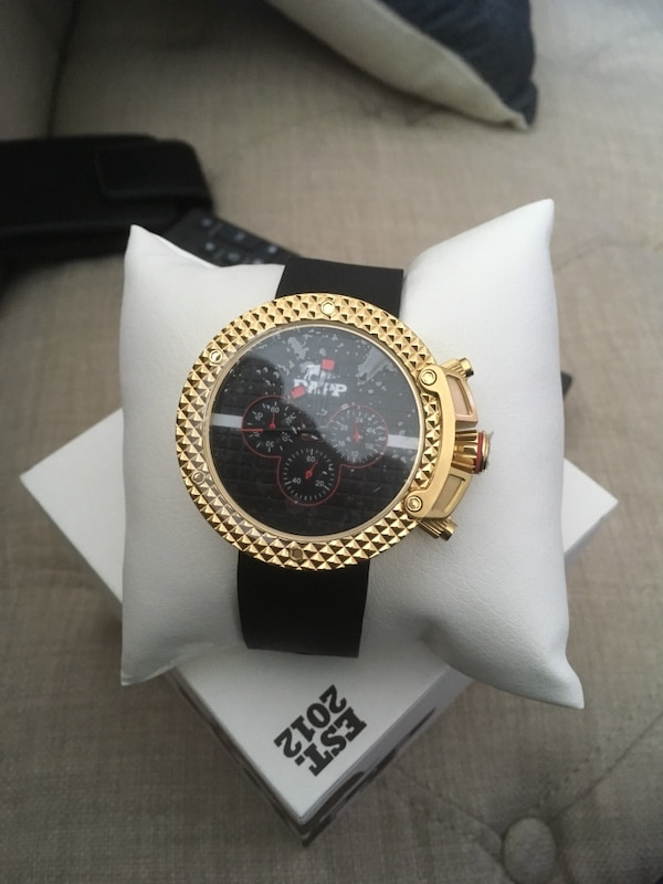 Round gold-colored chronograph watch with black strap