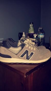 Pair of gray-and-black new balance 574 sneakers Georgetown