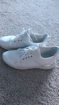 pair of white Nike low-top sneakers