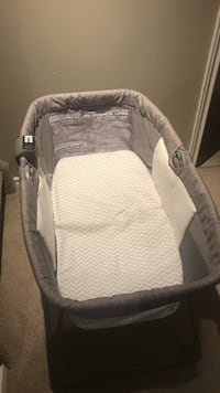 Baby's gray and white travel bassinet