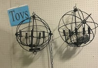 two round black wired candle holders