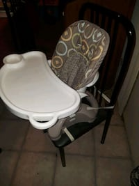 white and gray high chair.