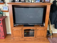 """Custom made brown wooden Entertainment center. Height-60"""" and width-62"""". Pictured with a 55"""" TV. TV, nick knacks, and electronics not included. Perfect upgrade for Super Bowl! Burbank, 91505"""