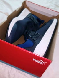 Blue,black and white Puma low top sneakers in box