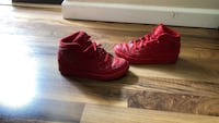 pair of red Nike high-top sneakers Burnaby, V5C 2J6