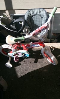 toddler's pink and white bicycle with training whe Abbotsford, V2T 2B5
