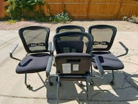 two black-and-gray folding chairs Denver, 80247
