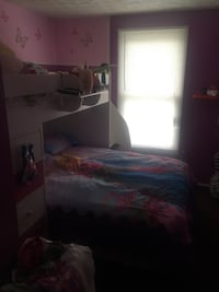 Girls bunk bed white and pink stairs and dresser built in .paid $2500.00 for it 4yrs ago Columbia, 21045