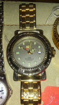 round black and gold analog watch with link bracelet Kings Mountain