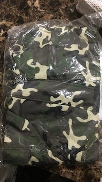Black, green, and grey camouflage textile Surrey, V3R 3X1
