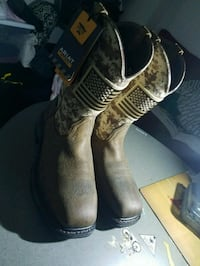 pair of brown leather cowboy boots Dallas