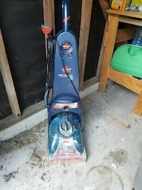 blue Bissell ProHeat upright vacuum cleaner