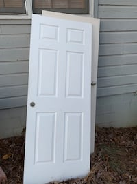 2 6-panel pre-hung doors. No cracks.