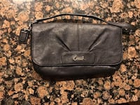 Coach wristlet black can be used as makeup pouch  Richmond, V6V 0B1