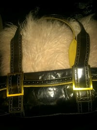 Purse by Kenneth Cole. Yellow suede trim and black leather.  Los Angeles, 90014