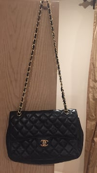 quilted black Chanel leather sling bag