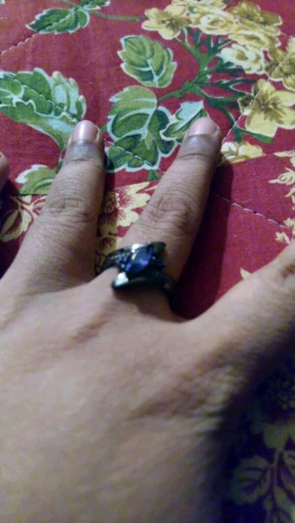 silver-colored ring with blue gemstone
