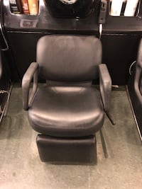 black leather padded rolling armchair Calgary, T2Z 0R1
