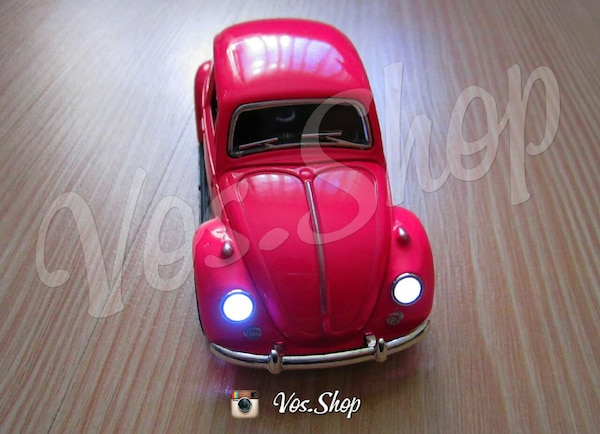 Pink And Silver Volkswagen Beetle Toy Car