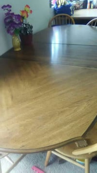 oval brown wooden dining table 27 km