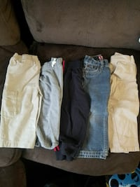 three pairs of denim jeans