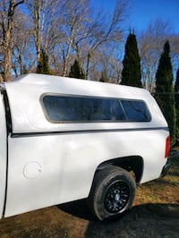 Truck bed camper shell topper