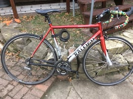 Red and white raleigh road bicycle