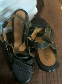 pair of black leather open-toe sandals Fort Myers