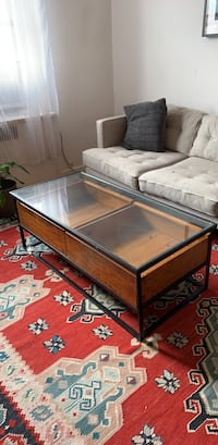 Brown wooden metal framed glass top coffee table New York, 10040