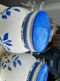 two white-and-blue floral ceramic canisters