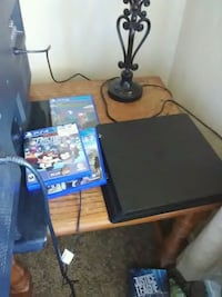 black Sony PS4 console with controller and game cases Abilene, 79603