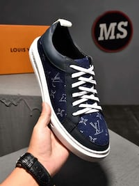black-and-blue Nike low top sneakers Queens County