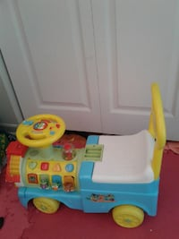 teal, yellow, and white ride-on toy car