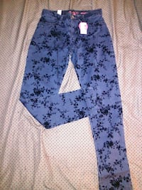 Brand new girls jeans w/black floral design Shirley, 11967