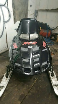 black and gray snowmobile 1961 km