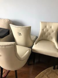 4 cream colored leathered dining chairs. Black legs. Perfect condition Rockville, 20852