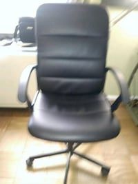 black leather office rolling armchair New York, 10036