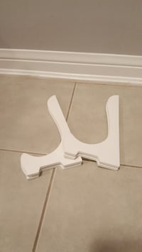 two white wooden book stands