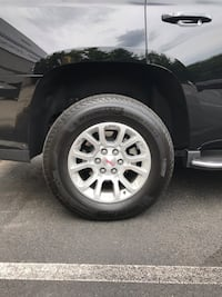 New GM wheels and tires set. Will fit GMC Chevy Gm Tahoe Yukon Suburban Sierra Silverado 18 inch factory wheel and Michelin tire 265 65 R18 with TPMS Manassas
