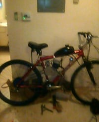 black and red full-suspension mountain bike