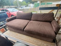Brown cloth couch with foot stool in separate chase