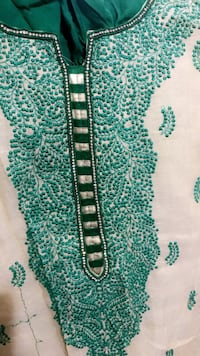 green and white floral textile 28 km