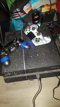 black Sony PS4 console with two game controllers Innisfil, L9S 2G1